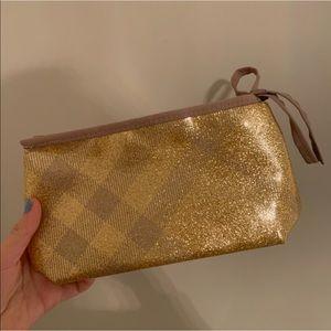 Handbags - Burberry gold shiny pouch